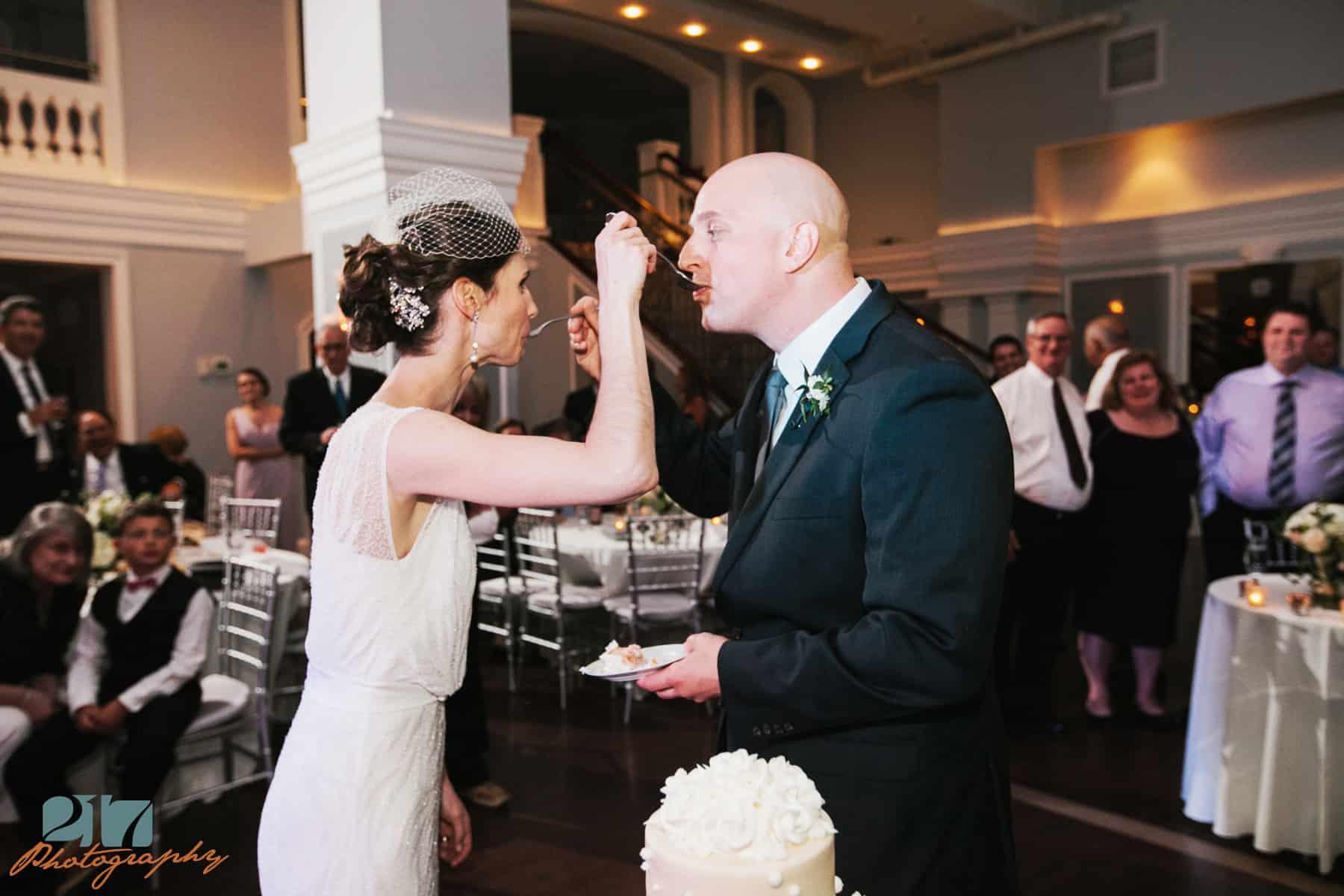 Cake cutting wedding photo